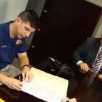 Firma de acuerdo entre FREMS y 9-1-1